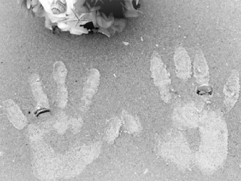 Handprints in sand