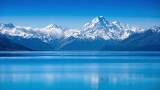 Photo of For honeymooners who want to experience Eden, New Zealand is a rare bastion of pure, untouched nature. Steaming volcanoes, giant kauri trees, and crystalline glaciers are just some of the amazing natural beauty of this country. For adventure, take a hot-air balloon ride or go alpine skiing, deep-sea diving or white-water rafting.
